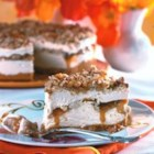 Butter Brickle Frozen Delight - A graham cracker crust is topped with layers of sweetened cream cheese and a pecan oat crumble and snaked throughout with caramel sauce.  Frozen and served cold.