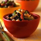 Three Bean Salad I - This peppy bean salad is a colorful mix of green, yellow wax, red kidney, garbanzo, and black beans, perked up by a dressing with mustard, cilantro and tarragon.