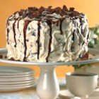 Amaretto Divine - Cake mix is flavored with almond liqueur to make this elegant three-layered cake which is filled with almond liqueur flavored whipped cream, drizzled with chocolate and sprinkled with crushed toffee candy bars.