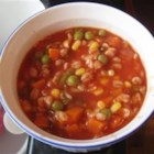 Colene's Easy Tomato Vegetable Soup - This is a quick soup made by combining canned tomato juice with oregano and a bag of mixed frozen vegetables.