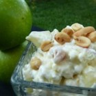 Taffy Apple Salad IV -  Miniature marshmallows, peanuts, apples and pineapple chunks are folded into a sweet vinegar and pineapple juice dressing, and then folded into a nice whipped topping. Makes eight generous servings.