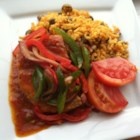 Tomato Chops II - This is pork chops with onions and peppers smothered in tomato sauce.