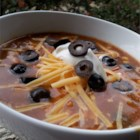 Chicken Enchilada Soup - This recipe takes the flavor of enchiladas and turns it into a hearty soup that's perfect for a blustery winter day.