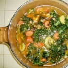 Sausage, Kale, and White Bean Soup - A comforting bean soup with spicy sausage and leafy kale. Easy to put together and delicious on a cold winter's day. You can substitute other sausage, onion instead of shallots, and other greens for the kale, and it will still be tasty!