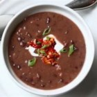 Quick and Easy Black Bean Soup - All you need is a couple cans of beans, an onion, some bacon, and spices to whip up this simple but delicious soup.