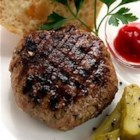 Asian Pork Burger - These ground pork burgers with apple and bell pepper are given an Asian flair with teriyaki sauce and ground ginger.