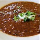 Black Bean and Tomato Soup - Pureed black beans give this hearty soup a creamy texture. Make it as spicy as you like by adding more or less red pepper flakes.