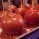 The Best Caramel Apples - Delicious homemade caramel coats tart apples for a yummy treat made from scratch. Get everything ready ahead of time because dipping the apples in the hot caramel goes very fast once you start.