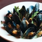 Drunken Mussels - White wine, garlic, and lemon combine to create a fragrant flavor in this classic steamed mussels recipe. Serve with grilled bread for a perfect way to savor the broth.