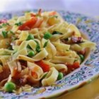 Pasta with Bacon and Peas - Pasta in a red sauce with bacon and peas.