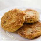 Frugal Fried Green Tomatoes - Only four ingredients are needed to make crunchy fried green tomatoes. They make a tasty side dish to any meal.