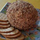 Southern Made Cheese Ball - This delicious cheese ball was developed and modified by me, and every time I serve it I am forced to share the recipe with everyone who tastes it. I roll mine in diced green onion, pecans (or other nuts) or bacon bits before serving. Try experimenting with different types of meats and cheeses. It's a great appetizer for any party. This one will be gone first. Enjoy!!