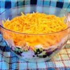 Gail's Seven Layer Salad - This colorful salad is a departure from the usual 7 layer salad.  Avocado, pinto beans, tortilla chips and ranch dressing give it a south-of-the-border flair.