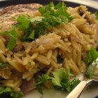 Mushroom Orzo - Orzo pasta and mushrooms are cooked with white wine in a rich butter sauce.