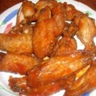 Buffalo Chicken Wings I - Deep-fried chicken wings are simmered in butter and hot sauce to pack quite a kick.