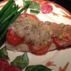 Orange Roughy with Sherry and Herb Sauce - Orange roughy is baked with tomatoes in a thick sherry and herb sauce.