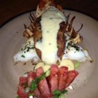 Cheesy Stuffed Lobster - Stuffed lobster tails smothered in cheese sauce....stop drooling!