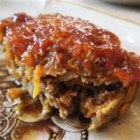 Best Ever Meat Loaf - Shredded Cheddar cheese is baked right into this easy meat loaf. Brown sugar, ketchup, and a touch of mustard make a delicious, sweet and tangy crust.
