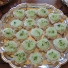 Easy Cucumber Party Sandwiches - Mix a tasty cream cheese spread flavored with dill and ranch dressing and spread on shaped pieces of white bread. Top with a cucumber slice and a few dill leaves for a quick and fresh appetizer or little snack.