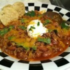 Chef John's Turkey Chili  - I served mine with some beautifully ripe slices of avocado that gives the final bowl another layer of silky richness. By the way, don't let the cocoa powder in our chili spice mixture throw you off! It's only a small amount and it really works. My chili was garnished with sour cream, diced jalapeno, cilantro and avocado.