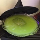 Melted Wicked Witch Punch - A tangy and delicious fruit punch with a funny green-brown color is served with a plastic witch hat floating on top.