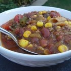 Quick Texas Stew - Browned ground beef is combined with cans of corn, minestrone soup, ranch-style beans and chopped tomatoes with chilies to create this Tex-Mex meal in a bowl.
