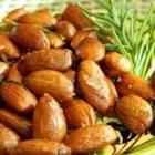 Rosemary and Garlic Infused Oven Roasted Almonds - Roasted almonds are tossed with rosemary and garlic-infused olive oil for a fragrant and savory snack that everyone will enjoy.