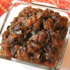 Green Tomato Mincemeat - Apples, oranges, lemons, brown sugar, raisins, oodles of spices and green tomatoes combine to make an incredibly flavorful concoction. Everything is simmered for hours on the stove before they are put into jars and sealed. Makes 30 pints of perfect stocking stuffers.