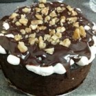 Rocky Road Cake - This is a chocolate 'crazy' cake with a nice chocolate-marshmallow frosting. The cake is mixed in the pan that it is baked in, and contains no eggs or dairy.