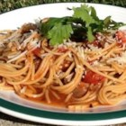 Pasta Pomodoro - Easy and light pasta with tomatoes and garlic. Cooked chicken breast chunks or shrimp can also be added to sauce for a great main dish!