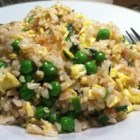 Mom's Smoked Salmon Fried Rice - The technique for making fried rice is adapted with non-traditional ingredients such as smoked salmon, peas, green and yellow onions in this easy, main dish recipe.