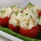 Creamy Shrimp Stuffed Cherry Tomatoes - Cherry tomatoes are stuffed with a creamy blend of shrimp, horseradish, and cream cheese.