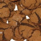 Molasses Sugar Cookies - These chewy cookies are made with molasses, brown sugar and shortening.  To achieve the chewy texture, allow cookies to cool on a flat surface rather than a rack.