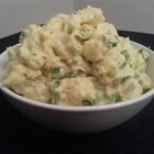 Sweet Potato-White Potato Salad - Give potato salad a modern update by combining white potatoes and sweet potatoes in a light mayo-sour cream dressing sparked with curry powder, lemon juice, and cilantro.