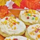 Soft Frosted Sugar Cookies - Vanilla-flavored sugar cookies bake up nice and soft. Frost them with an easy icing you can tint to any color.
