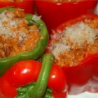 Bolognese Stuffed Bell Peppers - A creamy, spicy meat and tomato filling mixed with rice, and baked into stuffed bell peppers.