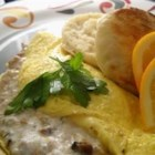 Tuna Cream Cheese Omelet - Perfect for dinner on a busy night, this omelet is filled with luscious cream and mozzarella cheeses, sliced black olives, and flaky tuna fish.