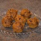 Mini Chocolate Chip Pumpkin Muffins - The easiest pumpkin muffins need just a box of spice cake mix, a can of pumpkin, and some miniature chocolate chips.