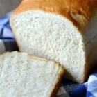Amish White Bread - This recipe will give you two loaves of plain, sweet white bread that are quick and easy to make.
