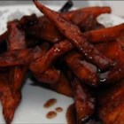 Cinnamon-Spiced Sweet Potato Fries - A sweet version of French fries, versatile sweet potatoes are tossed with a cinnamon-nutmeg-vanilla-sugar coating, then deep fried, and drizzled with a buttery, cinnamon sugar mixture.