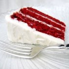 Red Velvet Cake - This classic red velvet layer cake is made tender with buttermilk. It's topped with a fluffy cooked white icing.