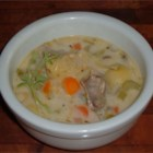 Elegant Oyster Soup - Oyster soup with carrots, mushrooms, onions, celery, and artichoke hearts.