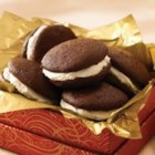 Nana Bessie's Whoopie Pies  - These classic chocolate whoopie pies filled with a thick layer of fluffy white frosting are a treasured family recipe from Grandma. They make great Christmas gifts.