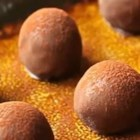 Holiday Rum Balls - Decadent yet deceptively simple, these rum balls are sure to be a hit at your next holiday dessert table!