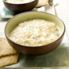 Creamy Chicken and Rice Soup - Cubes of cooked chicken and brown rice are added to this creamy soup made with roasted garlic chicken broth and roux-thickened milk.