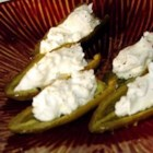 Feta Stuffed Jalapenos - Red jalapeno peppers are marinated then stuffed with cheese and served. Savory and spicy, these hot little appetizers are sure to make your mouth water and have you wanting more.