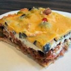 Easy Mexican Casserole - This Mexican casserole recipe made with layers of tortilla chips, beef, and salsa makes a quick and easy dish that will please the whole family.