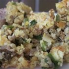 Mom's Delicious Oyster Corn Bread Dressing - Crumbled cornbread is mixed with sausage, oysters, and a mashed sweet potato in this yummy dressing!
