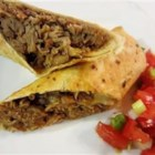 Easy Mexican Pork Burritos - Tender seasoned shredded pork fill these cheesy burritos that are lightly fried to a golden brown. You can also serve them as soft burritos.