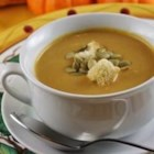 Curry Pumpkin Soup - Pumpkin puree and vegetable broth form the base of this cream soup flavored with curry and soy sauce.